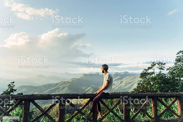 Photo of Man in mountains at sunset in Thailand