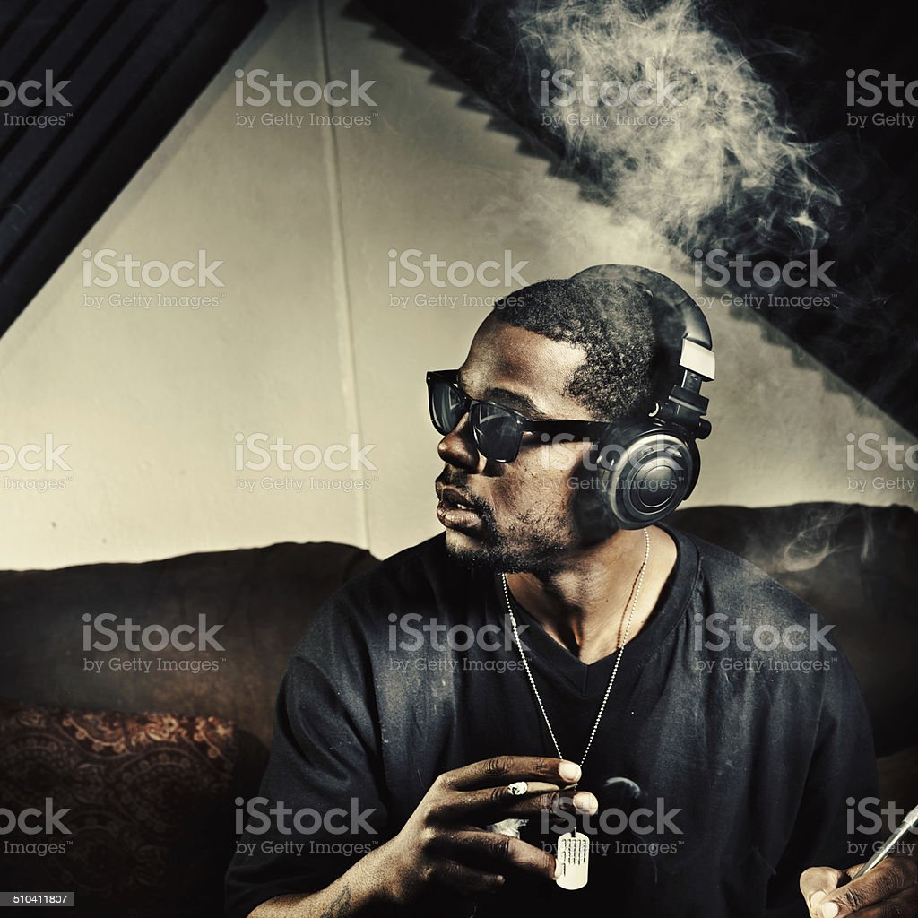 man in music studio smoking weed stock photo