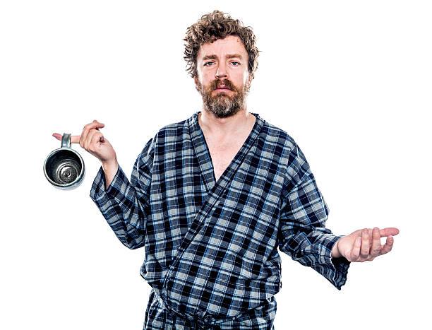 uomo in cerca del caffè mattutino - accappatoio foto e immagini stock