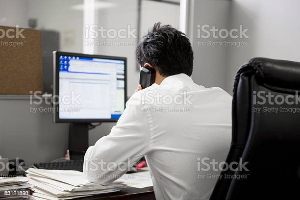 Man In Office On The Telephone Stock Photo - Download Image Now