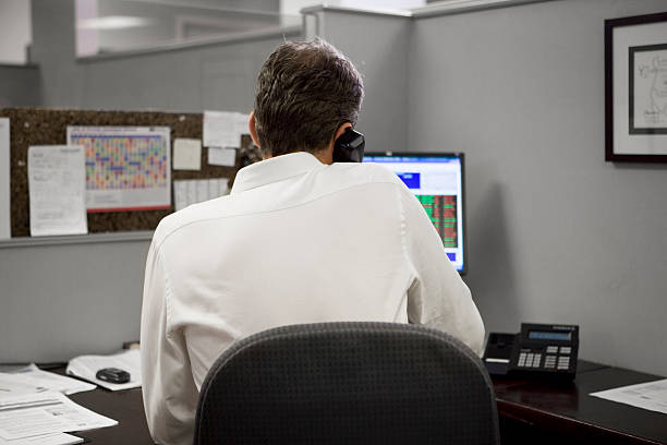 man in office on the telephone stock photo