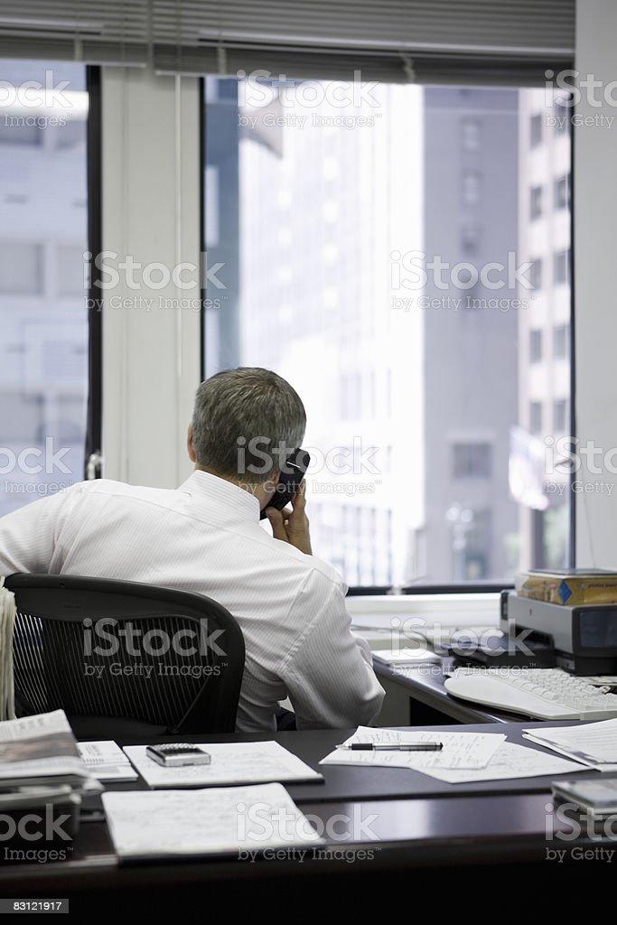 man in office on the telephone royaltyfri bildbanksbilder