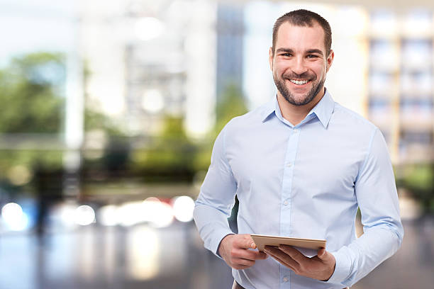 man in office with tablet computer - midsection stock pictures, royalty-free photos & images