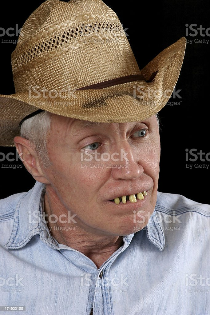Man in old hat and bad teeth stock photo