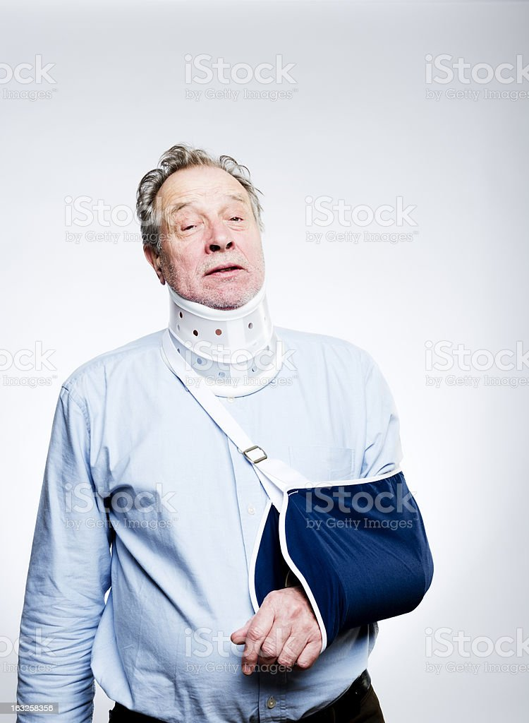 Man In Pain With Whiplash Injury Wearing  Brace and Sling stock photo