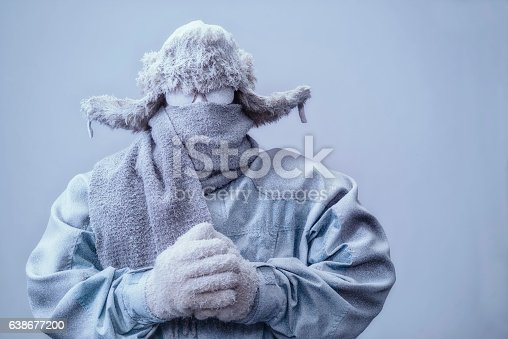 istock Man in parka, hat and scarf frozen from the cold 638677200