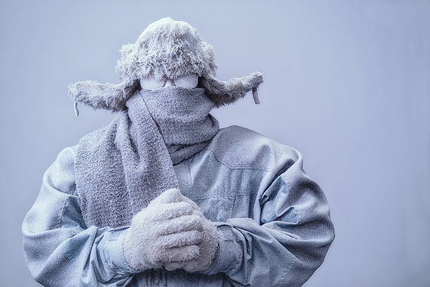 Man in parka, hat and scarf frozen from the cold - foto de stock