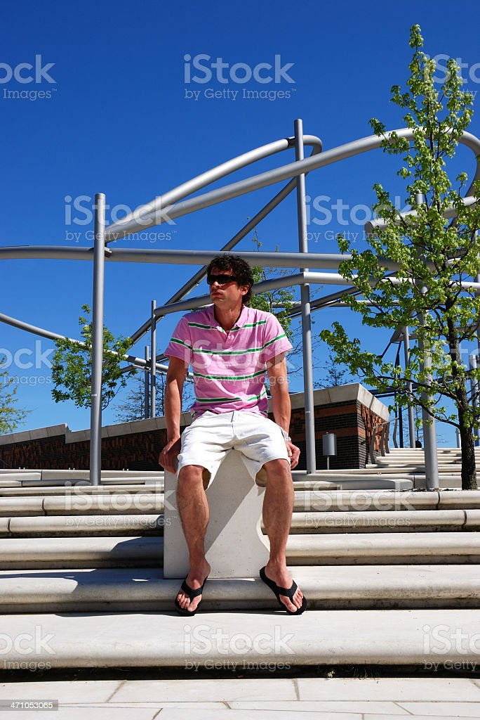 man in pink royalty-free stock photo