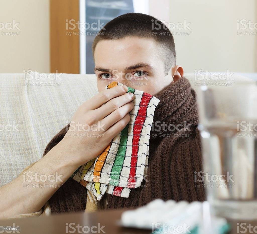 man in plaid using handkerchief stock photo