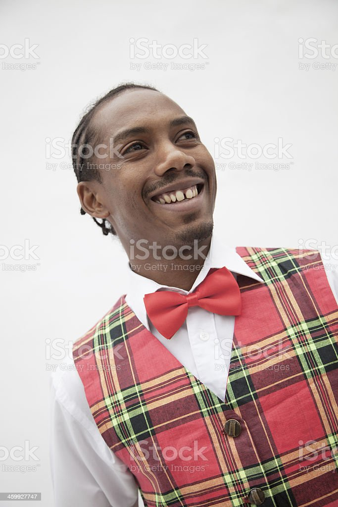 Man in plaid vest and red bow tie, studio shot stock photo