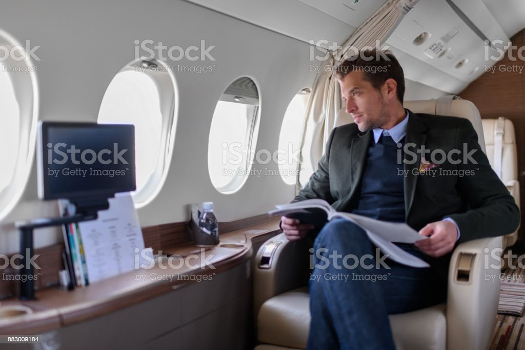Man in private jet airplane stock photo