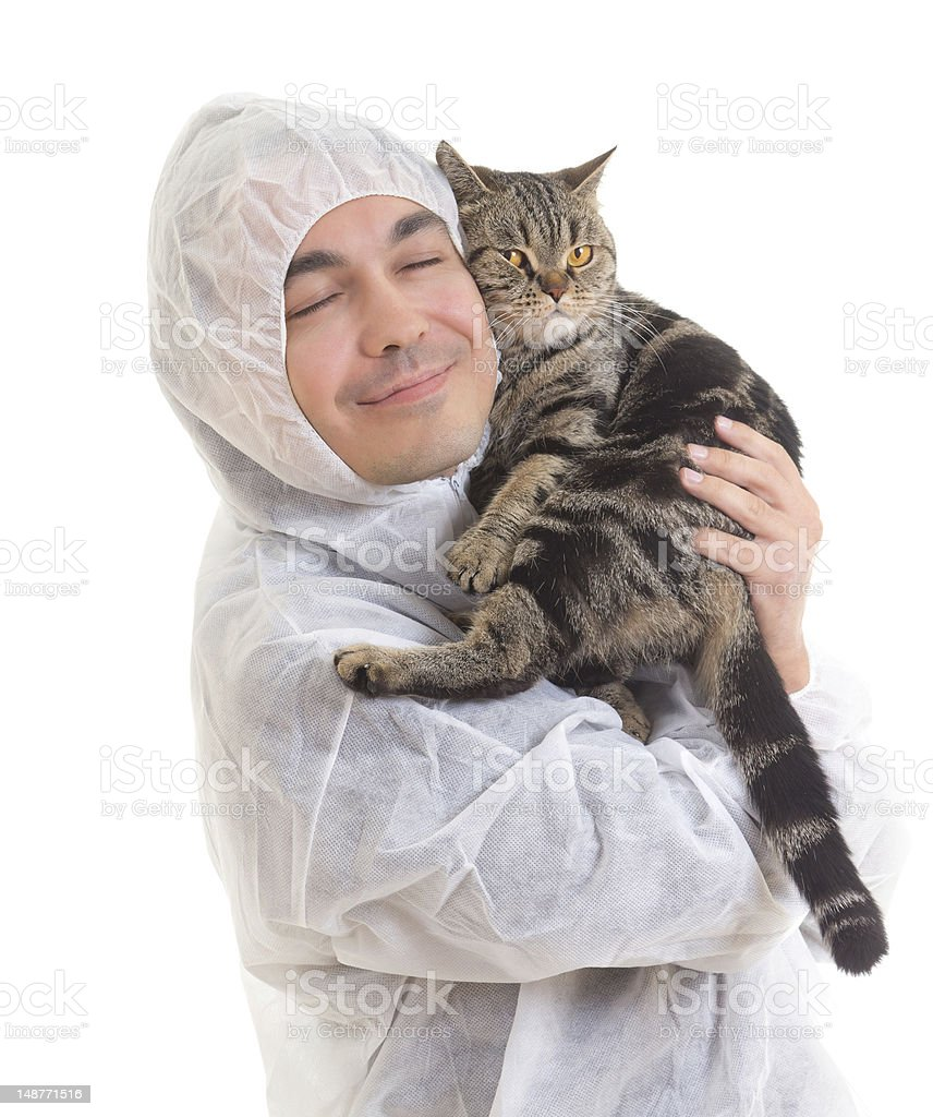 man in protective clothing holding a cat, isolated - Royalty-free Adult Stock Photo