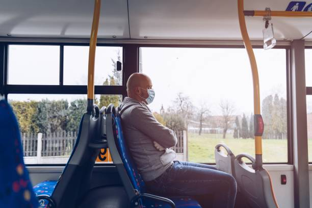Man in protective medical mask in bus. Public transport stock photo