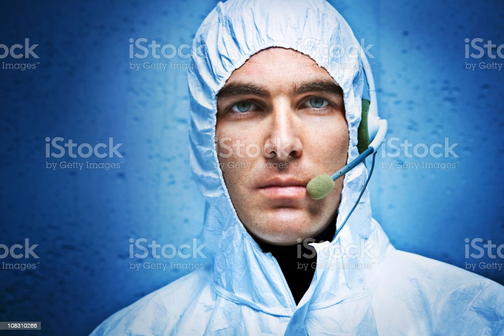 Man in protective workwear and headphones royalty-free stock photo