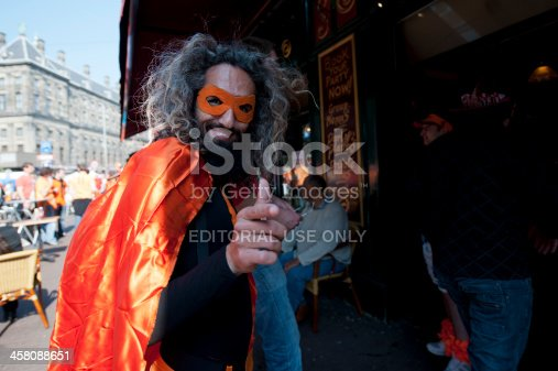istock Man in Queen's Day Fancy Dress and Mask 458088651