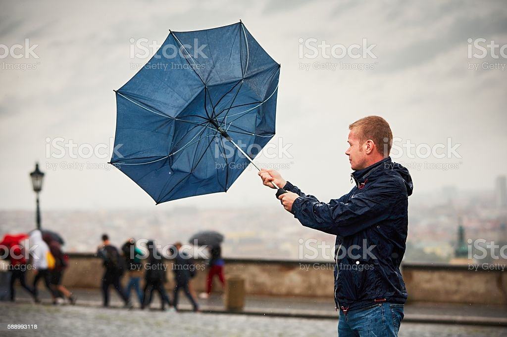 Man in rain stock photo
