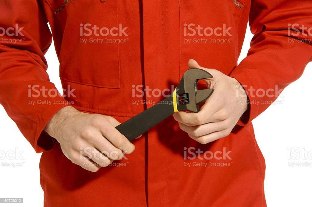 Man in red boiler suit with spanner royalty-free stock photo