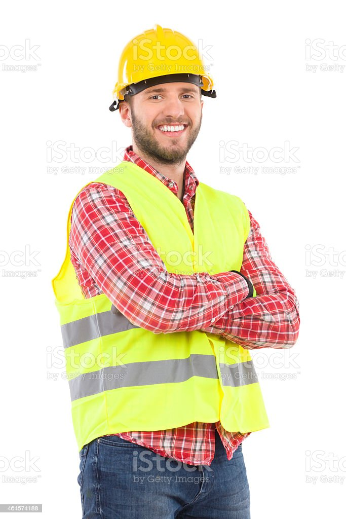 Man in reflective vest and hardhat stock photo