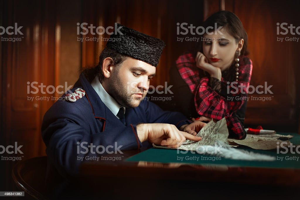 Man in retro clothing shaped reading the manuscript. stock photo