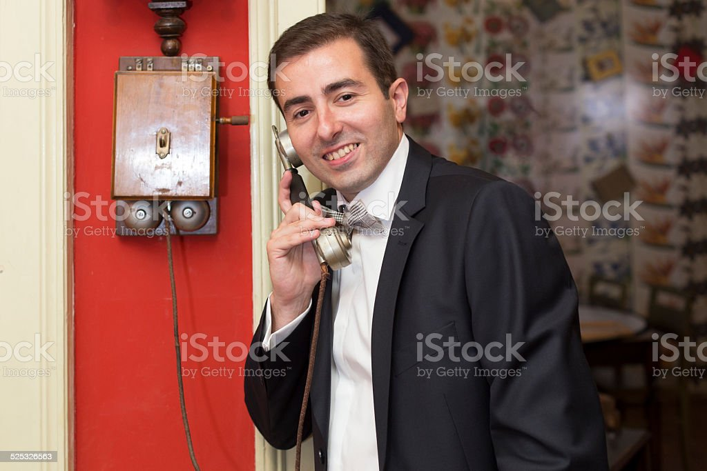 Man in Retro Room Answering at the Phone stock photo