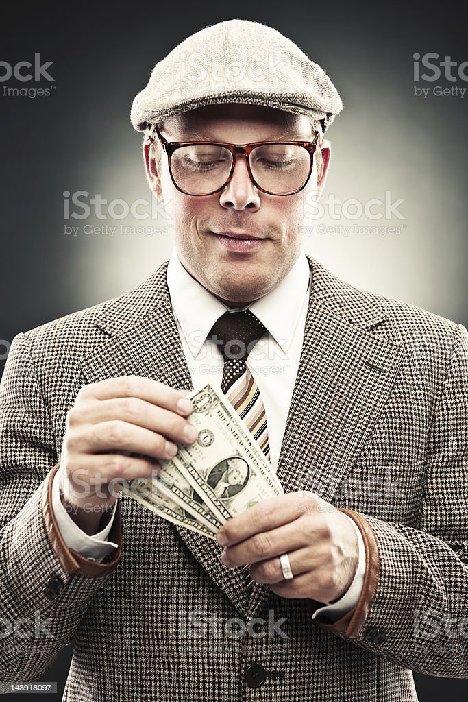 Man in retro suit counting money royalty-free stock photo