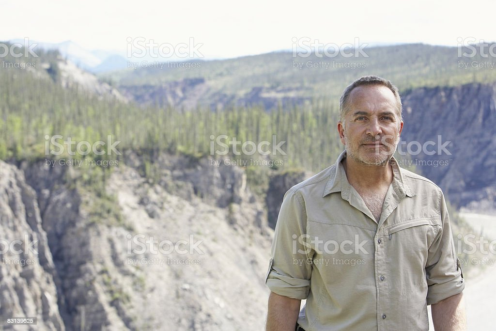 man in river valley royalty-free stock photo