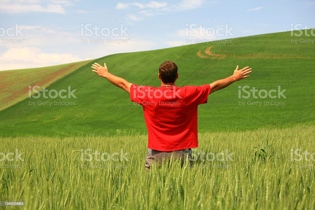 Man in Rural Setting Lifting Hands in Praise and Worship royalty-free stock photo