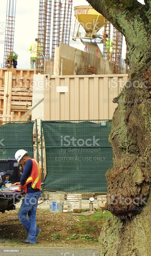 Man in safety vest at construction site stock photo