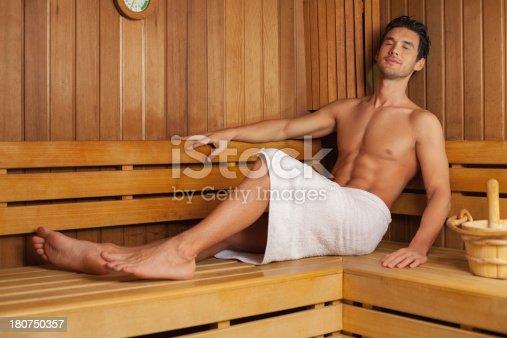 Young man relaxing in sauna.