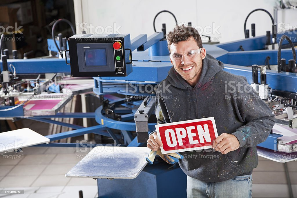 Man in screen printing business stock photo