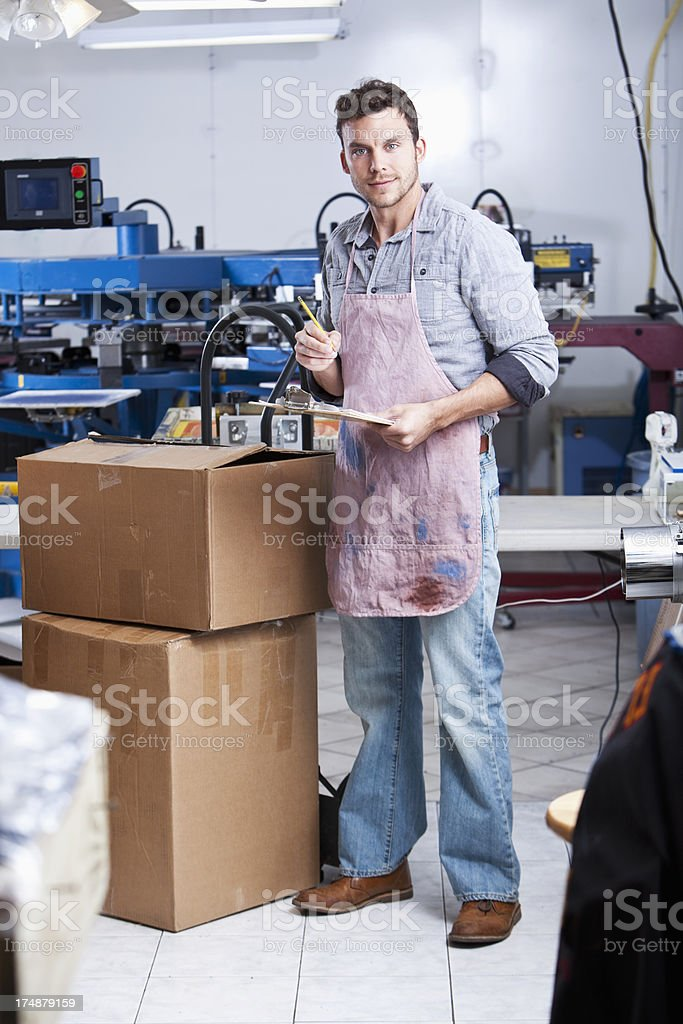 Man in screen printing factory royalty-free stock photo