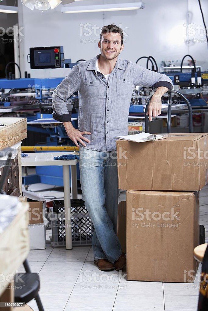 Man in screen printing factory stock photo