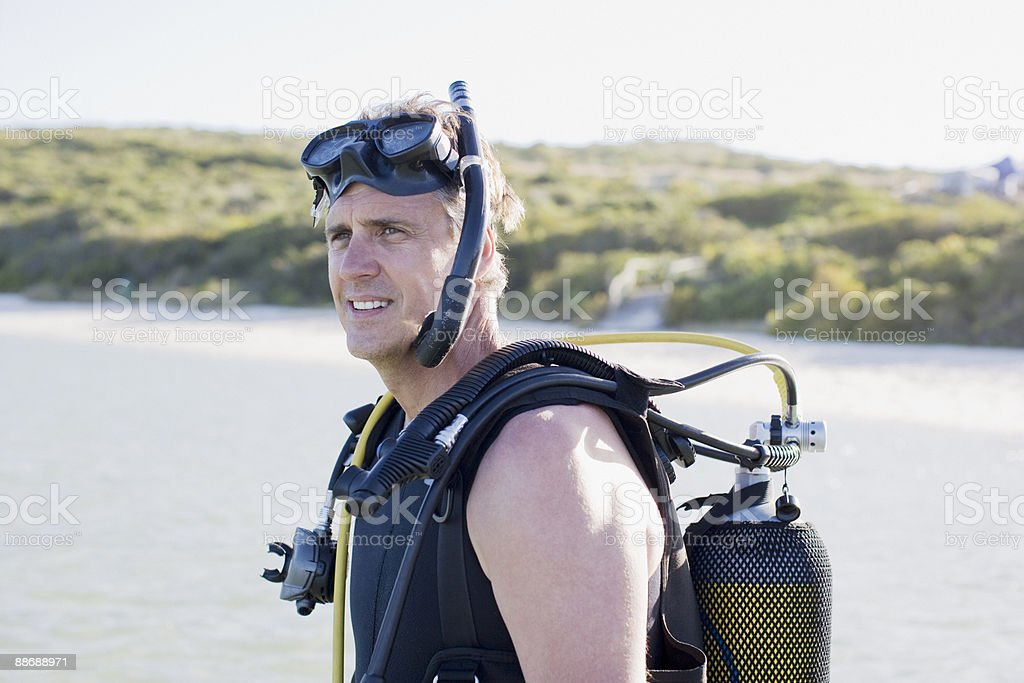 Man in scuba gear on beach royalty-free stock photo