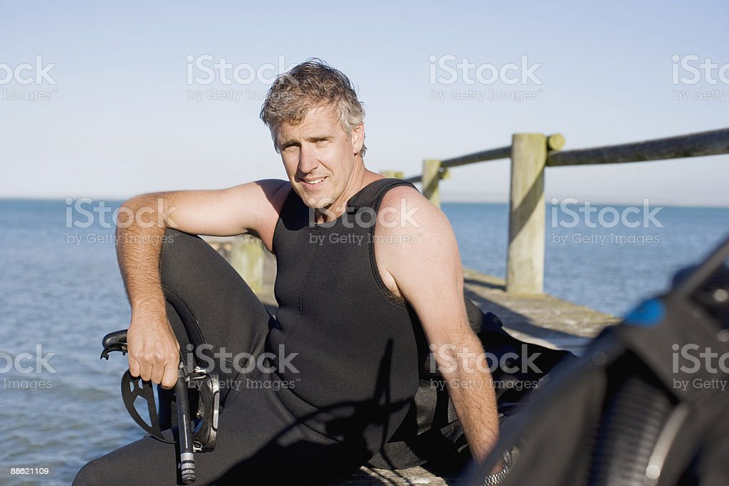 Man in scuba gear on pier royalty-free stock photo