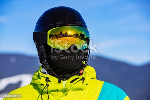 portrait of man in snowboard mask helmet and balaclava.