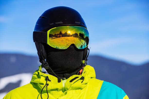 man in snowboard mask helmet and balaclava stock photo