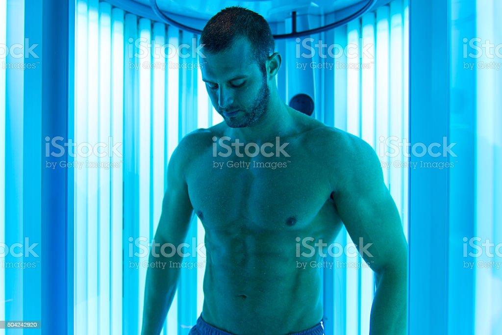 Man In Solarium stock photo