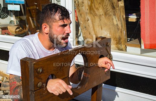 istock Man in Stocks for Charity 603190470