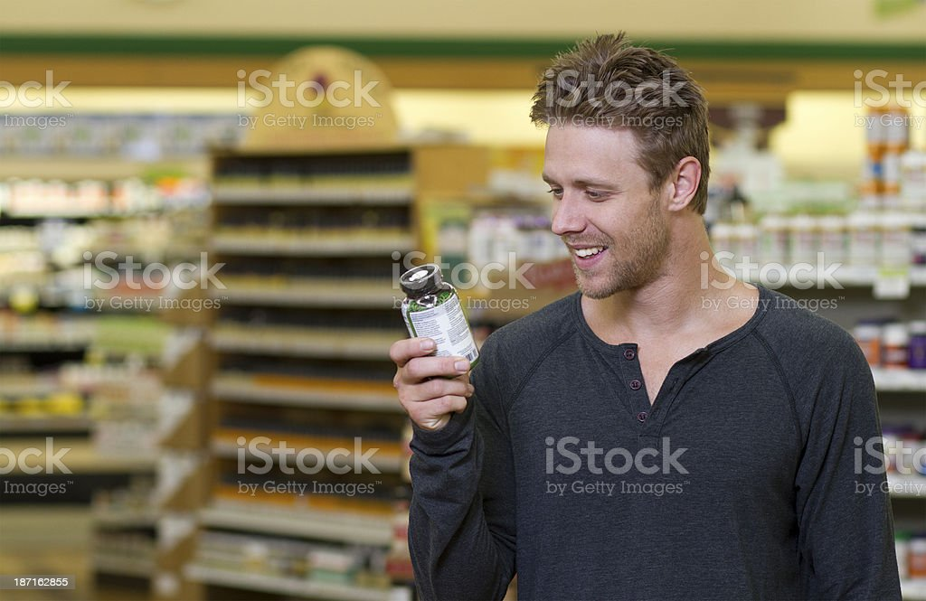 Man in Store Looks at Vitamins Shot in Loma Linda, California in July of 2013. 30-39 Years Stock Photo