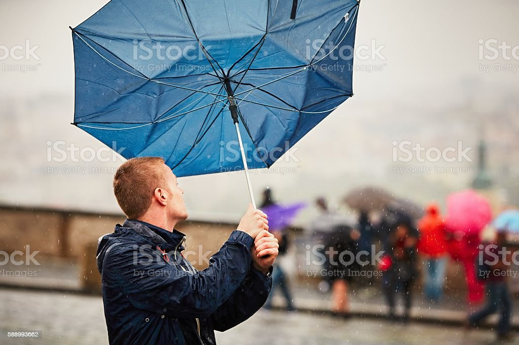 Man in storm stock photo