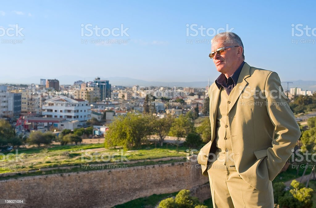 man in suit against the city royalty-free stock photo