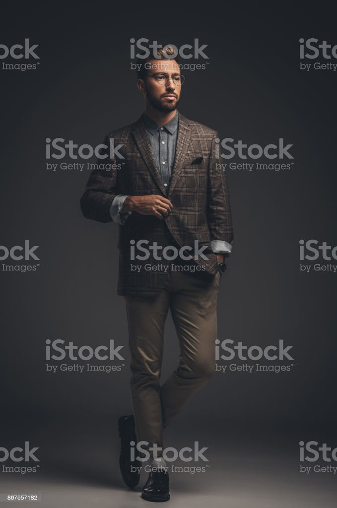 man in suit and glasses stock photo