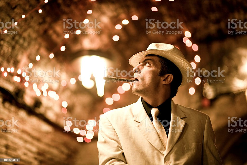 Man in Suit and Hat Smoking Cigar royalty-free stock photo