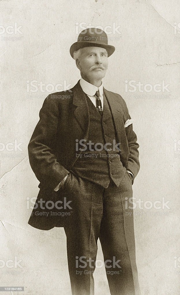 Man in Suit & Bowler Hat stock photo