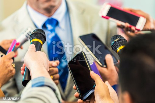 istock Man in suit confronted by media 534325054