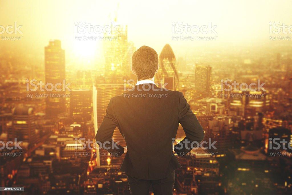 Man in suit facing London skyline stock photo