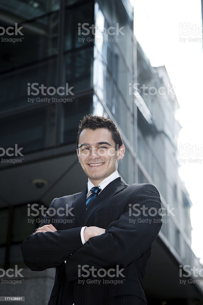 Man in Suit Folding Arms royalty-free stock photo