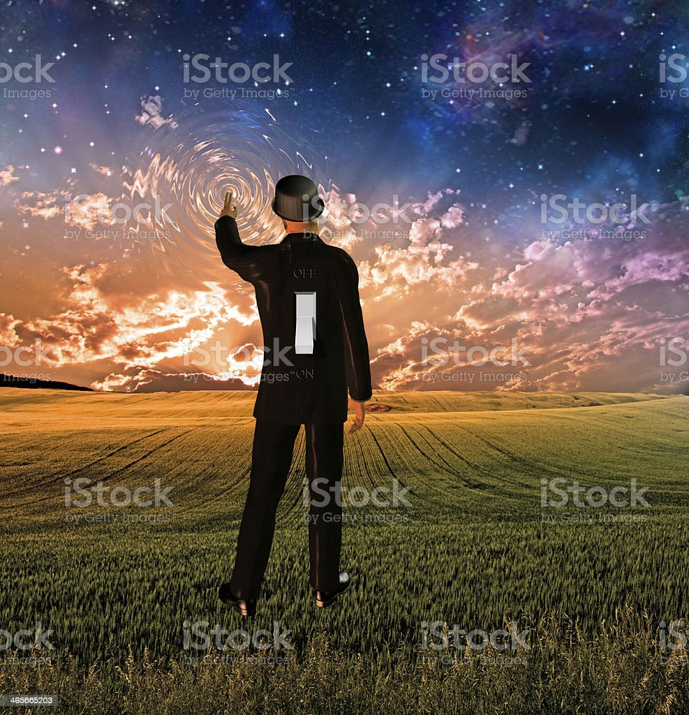 Man in suit has a switch touches sky creating ripples stock photo