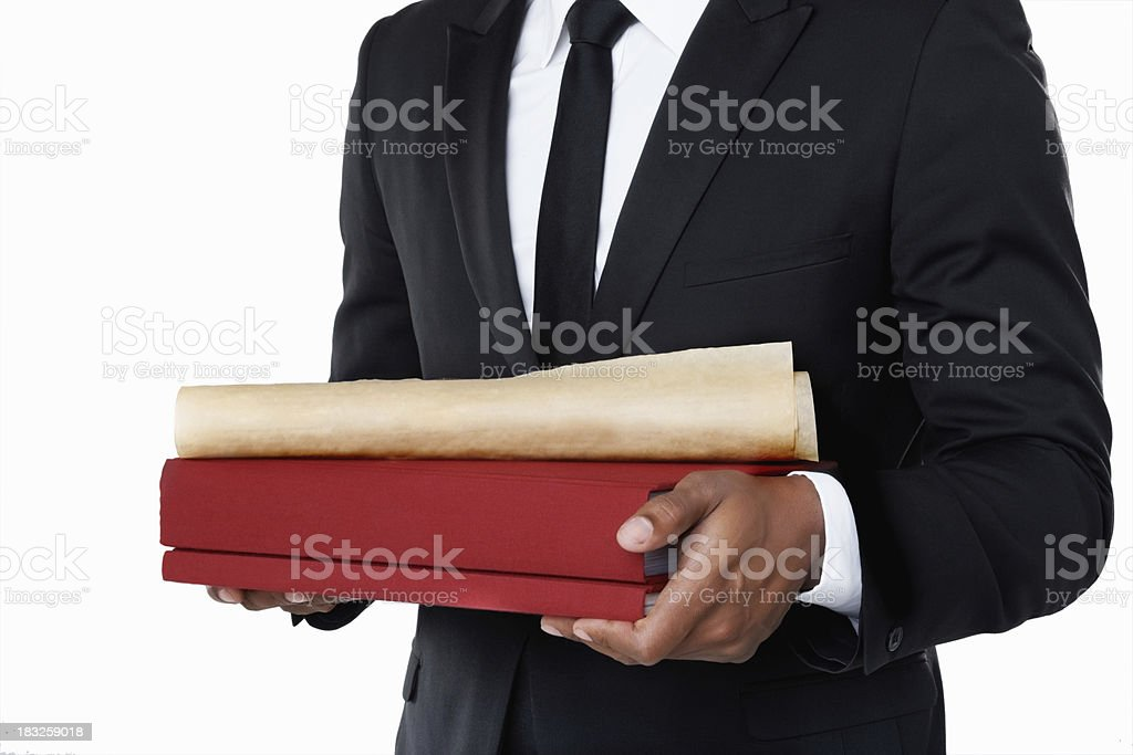 Man in suit holding law books against white background royalty-free stock photo