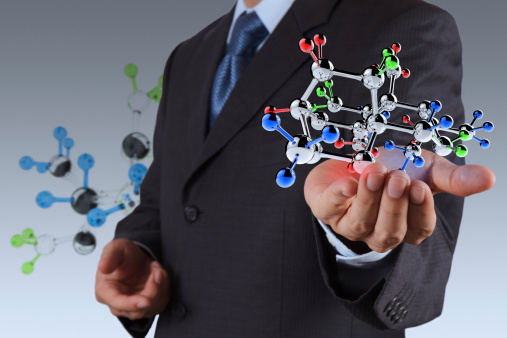 Man In Suit Holding Molecule Model In Hand Stock Photo - Download Image Now